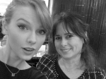 Taylor Swift wearing a necklace that says 13 together with Alexandra Shulman wearing a Chanel suite